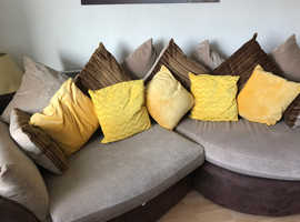 Comfortable shaped sofa in fairly good condition