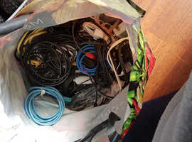 a half full bag  of various cables    ethernet  / connectors  etc