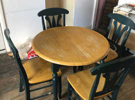 FREE wooden extendable dining table and four matching chairs