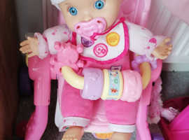 Interactive doll and pram