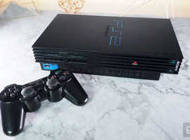 PlayStation 2 with 2 controllers