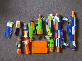 6 nerf guns, attachments, and ammo.