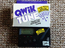 Automatic guitar tuner, electric, acoustic or bass.