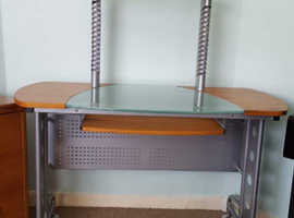 Sturdy computer desk with glass  and metal features