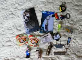 11 VARIOUS KEY RINGS AND BOTTLE OPENERS   MOST STILL ON BACKING CARDS