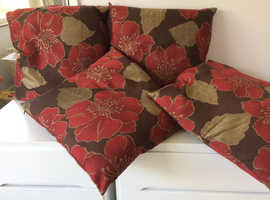 "Set of 4 18"" brown cushions with red flowers and gold leaves with gold detail."