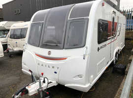 2015 BAILEY UNICORN CARTEGENA  TWIN AXLE  FIXED ISLAND BED TOURING CARAVAN  Subtitle: 4 BERTH  FULLY SERVICED  IMMACULATE  1 OWNER