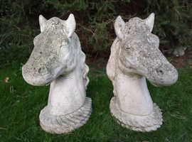 Beautiful old pair of stone horses heads