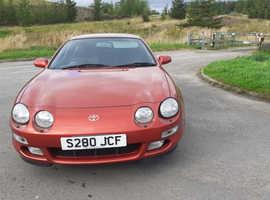 Toyota Celica, 1998 (S) Orange coupe, Manual Petrol, 194030 miles