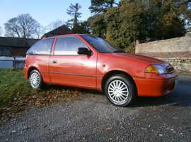Suzuki Swift, 1999 (V) Red Hatchback, Manual Petrol, 103,000 miles