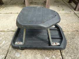 Wheeled stool.