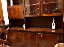 Dark wood dinning room cabinet .