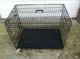 Dog cage with two doors