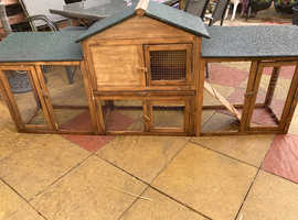 Rabbit hutch with upstairs sleeping quarters.