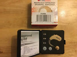 Hearing amplifier new, unwanted spare hearing aid. With 3 batteries in case