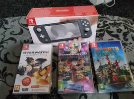 Nintendo switch lite in grey with 3 games brand new