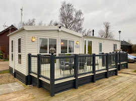 Modern caravan with decking for sale at Tattershall Lakes Country Park in Lincolnshire