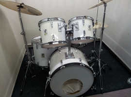 Retired drum teacher has several mid range drum kits for sale from £350.