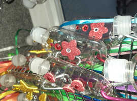 Empty bottles for hand gel with clips and lanyard