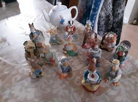 Beatrix potter tea pot, and figurine's + books