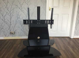 Tv stand with two glass shelves will take 65 inch flat screen tv