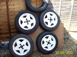 14 INCH FORD ALLOY WHEELS & 3 GOOD TYRES.