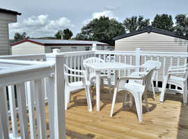 George is a 2 bedroom, non-smoking and no pets, double-glazed, gas central heated caravan in WATERSIDE HOLIDAY PARK & SPA