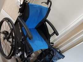 Power pack electric self propelled wheel chair, like new, can deliver