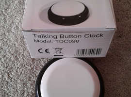 AS NEW. TALKING BUTTON CLOCK. HARDLY USED.