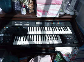 Electric keyboard with music stand