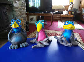 3 funky pottery birds.