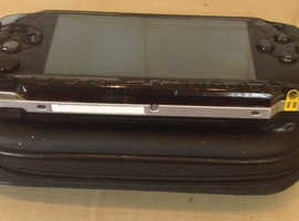Sony PSP with charger and case.