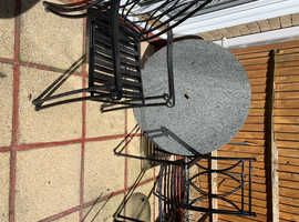 Granite table four chairs