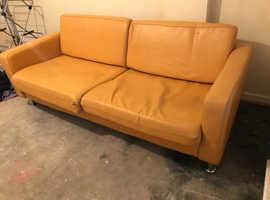 Two seater mustard sofa