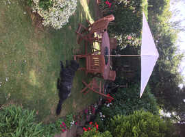 Circular garden table 6 chairs and parasol