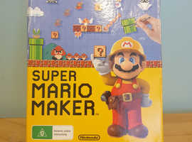 Wii u Super Mario maker limited edition with art book.