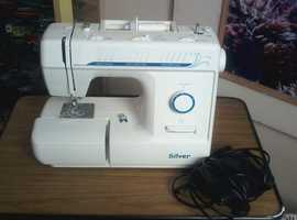 sewing machine,  hardly used.