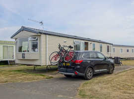 Swift Loire 2014 at Church Farm Holiday Park, Pagham, W Sussex