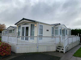 STUNNING STATIC CARAVAN / LODGE FOR SALE WITH DECKING IN SKEGNESS CLOSE TO THE BEACH NR INGOLDMELLS / SITE FEES INCLUDED