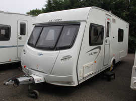 Lunar Ultima 544 2012 4 Berth Fixed Bed Caravan + Large Air Pumped Porch Awning (Oxygen Speed II)
