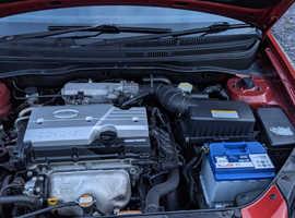 Kia Rio LS. 2007. 5 Door Hatchback, 52,000 miles in metallic red. 1.4 litre petrol.