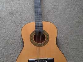 A classical guitar ' with a soft cover 'STAGG'