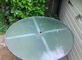 Round glass top garden table