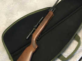 Air Rifle with scope and silencer