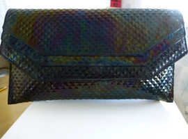 Beautiful petroleum colour leather clutch handbag