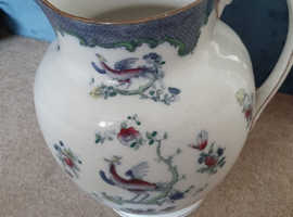 Large antique jug with pheasant design