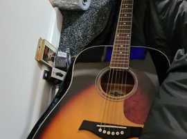 Acoustic guitar and starter kit