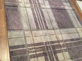 Purple and grey checked rug