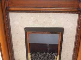 ELCTRI FIRE WITH SURROUND AND HEARTH