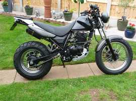 rt125d with new mot the best little bike you will ever own. v -  low miles